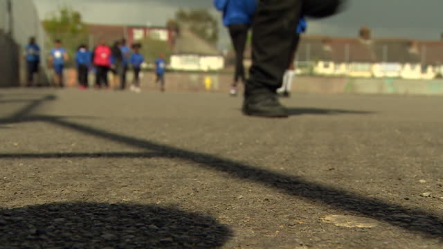 views of primary school children in a playground - defocussed stock videos & royalty-free footage