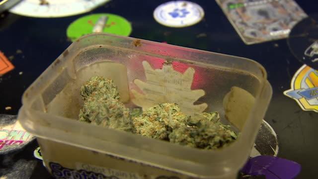 views of recreational cannabis being smoked - ボング点の映像素材/bロール