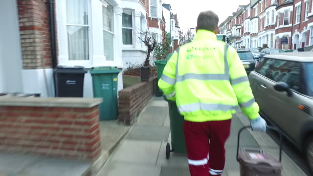 views of rubbish bins being collected - bin stock videos & royalty-free footage