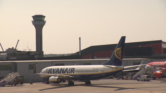 views of ryanair planes grounded due to the coronavirus outbreak - stationary stock videos & royalty-free footage