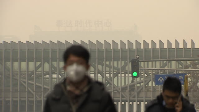 views of smog in the streets of beijing china - pollution mask stock videos & royalty-free footage