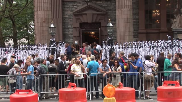 views of st paul's chapel just after 10th anniversary ceremony / people gathered to view tie a ribbon of remembrance art exhibit new york city... - paranoia stock videos & royalty-free footage
