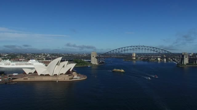 views of sydney harbour, sydney, and sydney opera house in the morning. sydney harbour serves as the central hub for water based traffic, tourism,... - water taxi stock videos & royalty-free footage