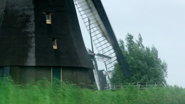 views of the base of old-fashioned windmill, netherlands - wind turbine stock videos & royalty-free footage