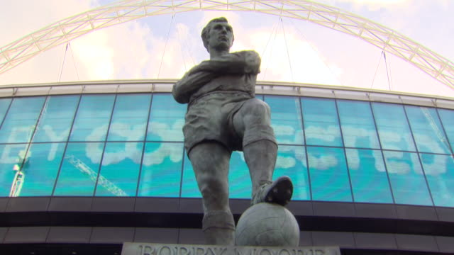 views of the bobby moore statue outside wembley stadium - wembley stock videos & royalty-free footage