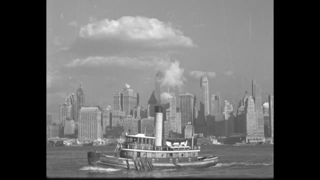 VS views of the building seen through tree branches / Manhattan skyline with passing tugboat in Hudson River / Empire State seen from street and a...