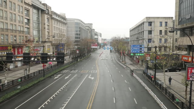 views of the city of hangzhou as it is under almost complete lock down with only essential services available and residents discouraged from leaving... - major road stock videos & royalty-free footage