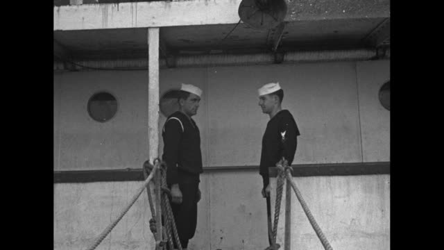 "views of the danish ship ""nora"" and suited men descending the gangplank / captain of the nora with the men attaching a confiscation notice on door... - robin day stock videos & royalty-free footage"