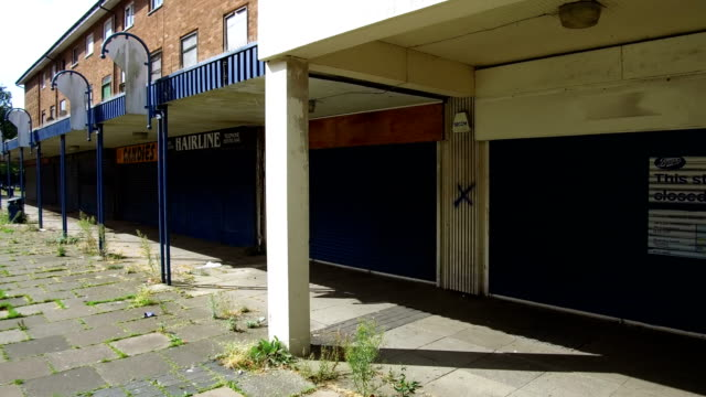 views of the derelict and neglected poolway shopping centre and social housing complex in garretts green on august 22, 2018 in birmingham, england.... - housing development stock videos & royalty-free footage