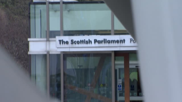 views of the eu scottish and british flags outside the scottish parliament building - flag stock videos & royalty-free footage