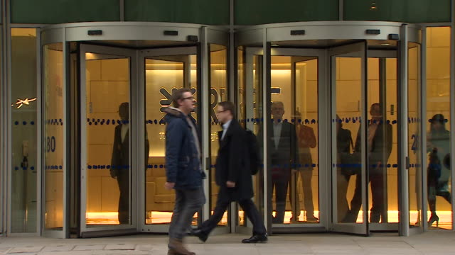 views of the front door to the royal bank of scotland headquarters in canary wharf - revolving door stock videos & royalty-free footage