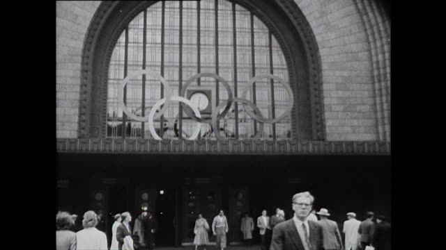 views of the helsinki central station and busy streets with trams and pedestrians during the 1952 helsinki summer olympics - 1952 stock videos & royalty-free footage