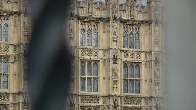 views of the houses of parliament through railings - clock tower stock videos & royalty-free footage