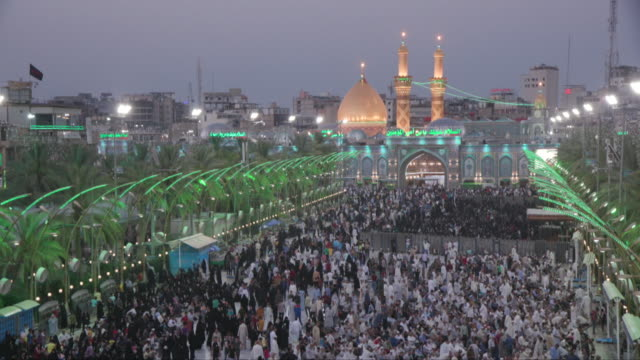 views of the imam hussain shrine in karbala, iraq - wallfahrt stock-videos und b-roll-filmmaterial