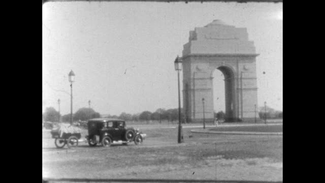 views of the india gate; the arch was built as a memorial to fallen british india army soldiers. - colonial stock videos & royalty-free footage