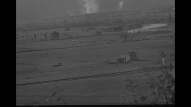 vs views of the italian countryside american soldiers firing howitzer shells bursting in valley far away men firing howitzer smoke in valley hands... - pontoon bridge stock videos and b-roll footage