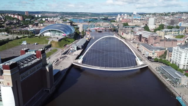views of the millenium bridge over the river tyne in gateshead - newcastle upon tyne video stock e b–roll