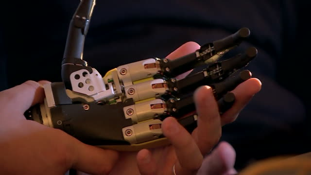 views of the rome-based team behind a new bionic hand, which can be controlled by thought-processes of the user, discussing their project. - fühler stock-videos und b-roll-filmmaterial