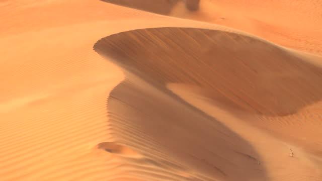 views of the rub al khali desert in saudi arabia and an oil refinery - desert stock videos & royalty-free footage