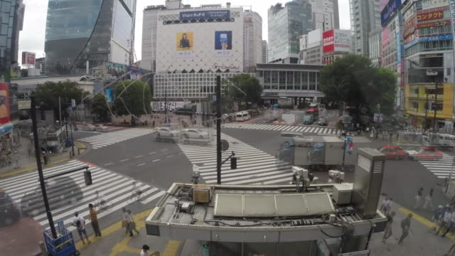 views of the shibuya crossing in tokyo - pedestrian stock videos & royalty-free footage