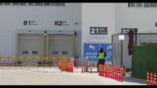 views of the tesla giga factory as it has resumed operations following the extended chinese new year holidays in shanghai china on monday 17 february... - shanghai stock videos & royalty-free footage