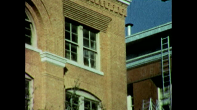 views of the texas book depository days after jfk's assassination - attentat auf john f. kennedy stock-videos und b-roll-filmmaterial