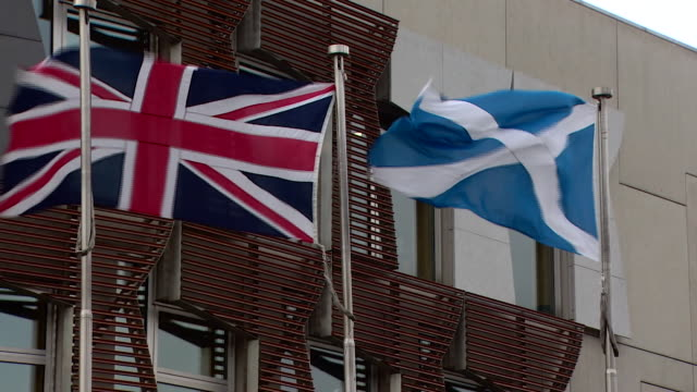 Views of the Union Jack and Scottish flag outside the Scottish parliament building in Edinburgh
