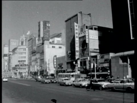vidéos et rushes de views of tokyo high angle view of city skyline / traffic along busy city street / traffic along new super highway / bridges and flyovers new highrise... - 1964