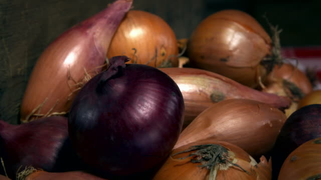 cu views of varied onions in rustic crates - focus on foreground stock videos & royalty-free footage