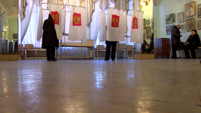 views of voting booths and a poster of candidates in the 2018 russian general election - poster stock videos & royalty-free footage