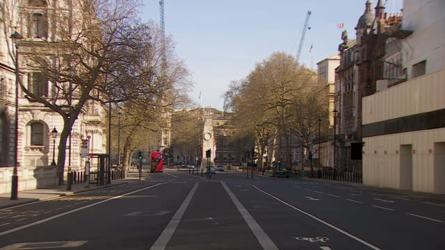 views of whitehall during the coronavirus lockdown - double decker bus stock videos & royalty-free footage