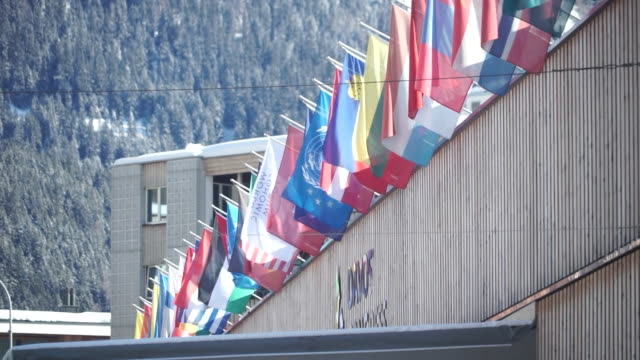 views outside the world economic forum in davos - national flag stock videos & royalty-free footage