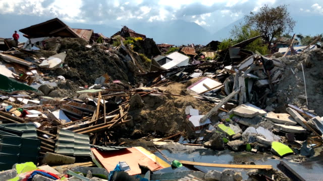 views the rubble and debris of destroyed buildings following an earthquake on october 02 2018 in palu indonesia indonesias disaster response agency... - damaged stock videos & royalty-free footage