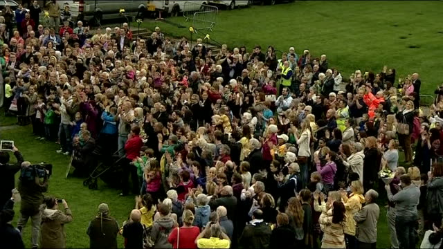 vigil for cancer sufferer and fundraiser stephen sutton ends; england: staffordshire: lichfield: lichfield cathedral: int various of large crowd... - スタッフォードシャー リッチフィールド点の映像素材/bロール