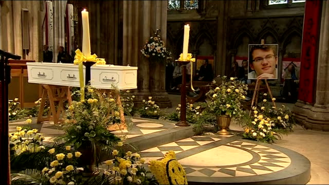 vigil for cancer sufferer and fundraiser stephen sutton ends service at lichfield cathedral various of the coffin with photograph of stephen sutton... - religious service stock videos and b-roll footage
