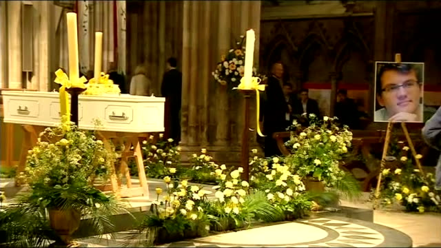 vigil for cancer sufferer and fundraiser stephen sutton; lichfield cathedral: int coffin on trestles surrounded by flowers and with a picture of... - リチャード・パロット点の映像素材/bロール
