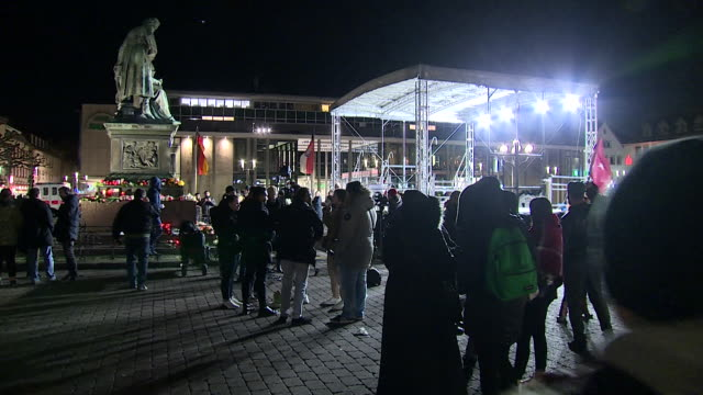 vigil in hanau after the killing of nine people in a shisha bar, that is being treated as a terror attack - gedenkveranstaltung stock-videos und b-roll-filmmaterial