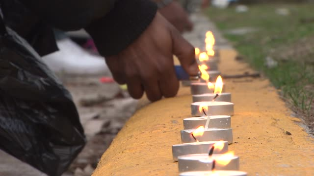 "vigil was held on chicago's south side near the spot where the rapper mario hess, known as ""big glo"" and ""blood money,"" was shot 10 times. hess was... - candlelight stock videos & royalty-free footage"