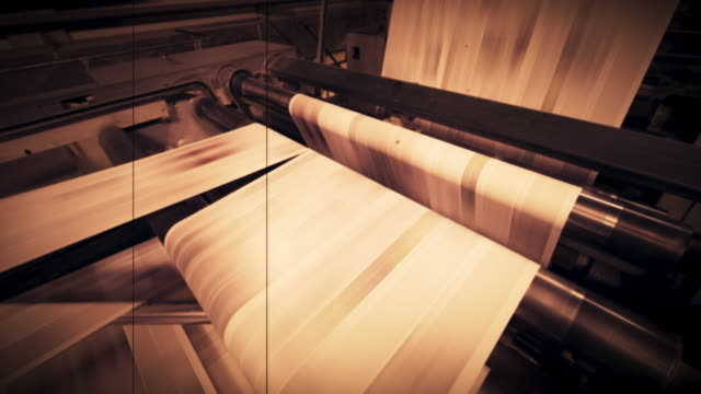 ld vignette: paper sheet moving fast through the machine in the newspaper printing factory - vignette stock videos & royalty-free footage