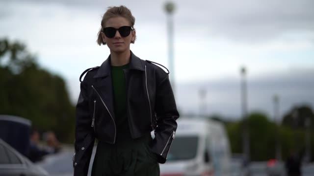 vika gazinskaya wears a black leather jacket a green top green pants outside hermes during paris fashion week womenswear spring/summer 2018 on... - hermes designer label stock videos and b-roll footage