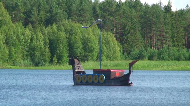 viking boat floating - viking stock videos and b-roll footage