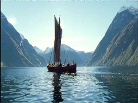 viking fishing boat in fjord in sunshine norway - viking stock videos and b-roll footage