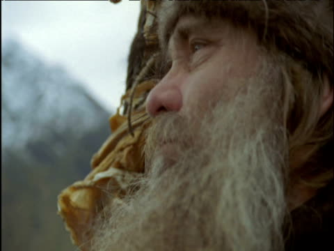 viking looks around and eats dried fish on long ship norway - viking stock videos and b-roll footage