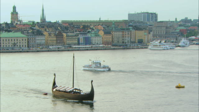 ws viking ship and djurgã¥rds ferry in streem / stockholm, stockholm, sweden - viking stock videos and b-roll footage