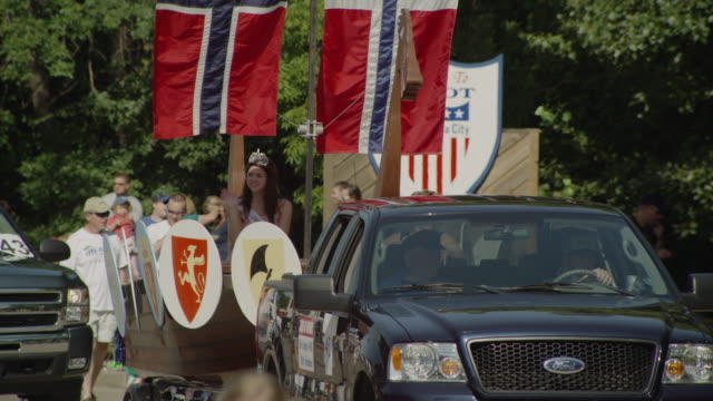 viking ship with swedish flag and a princess is pulled by a pick up in a small town parade. - swedish flag stock videos and b-roll footage