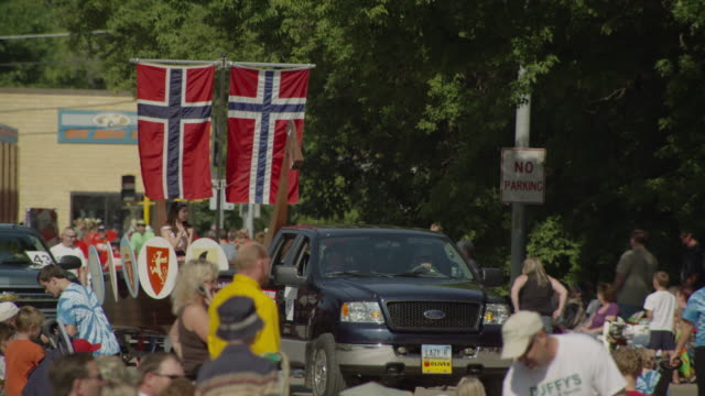 viking ship with swedish flag is pulled by a pick up in a small town parade. - swedish flag stock videos and b-roll footage