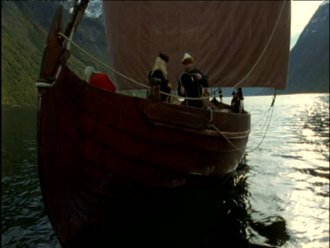 vikings on long ship in fjord norway - viking stock videos and b-roll footage