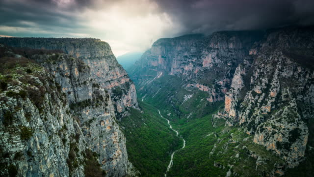 aerial: vikos canyon in greece - ravine stock videos & royalty-free footage