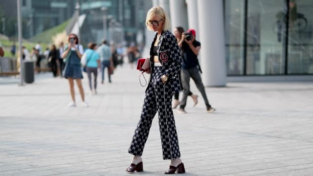 Viktoria Rader wearing glasses Gucci suit cropped top heels socks is seen outside Alberta Ferretti during Milan Fashion Week Spring/Summer 2019 on...