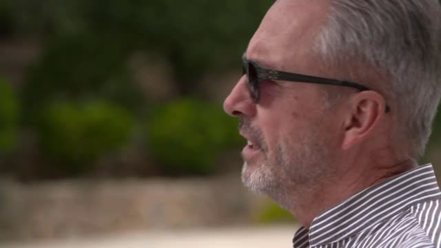 the rise of holiday fraud in 2019 spain mallorca ext reporter to camera sot klaus rainer interview sot various shots of clare taylor in phone call... - majorca stock videos & royalty-free footage